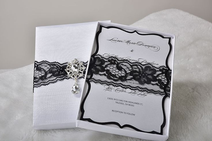 Melania Invitation box: Handmade, modern design, beautiful lace makes it stand out. The dangling crystal embellishment makes the invitation so unique. The invitation is handcrafted of fine silk. Boxed Wedding invitation