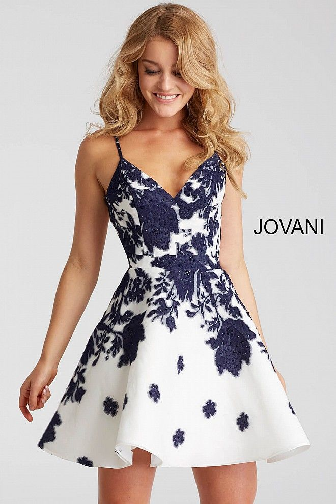 Fit and flare ivory short dress with navy embellished print features sleeveless v neck bodice with spaghetti straps and open back.