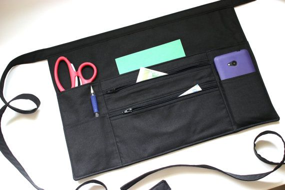 black half apron with two zipper pockets by Tracey Lipman