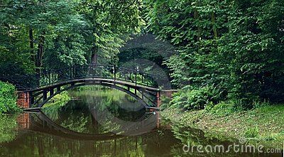 The bridge and trees in park in Pszczyna in Poland