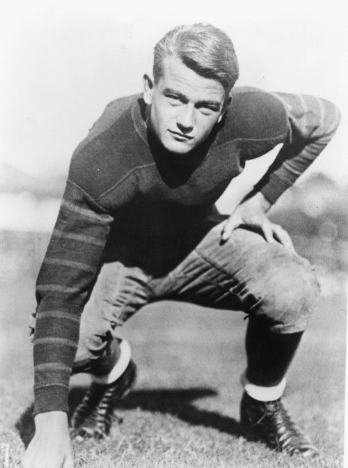 Marion Morrison's academic and athletic success at Glendale High led to a football scholarship at the University of Southern California (USC).A body surfing accident at Newport Beach cut short his promising athletic career, so the former tackle looked to studio work to help pay his tuition. In a film called The Big Trail, Marion Morrison became John Wayne, and the movie business – and the country – would never be the same.