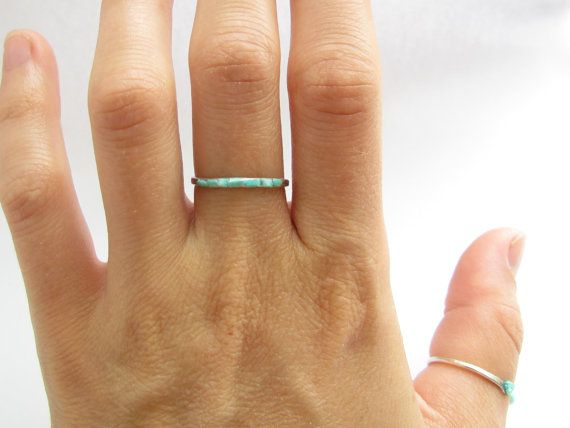 This adorable ring is made from argentium sterling silver or 14k gold filled metal - you choose. Usually I use 7 stones on hammered all over