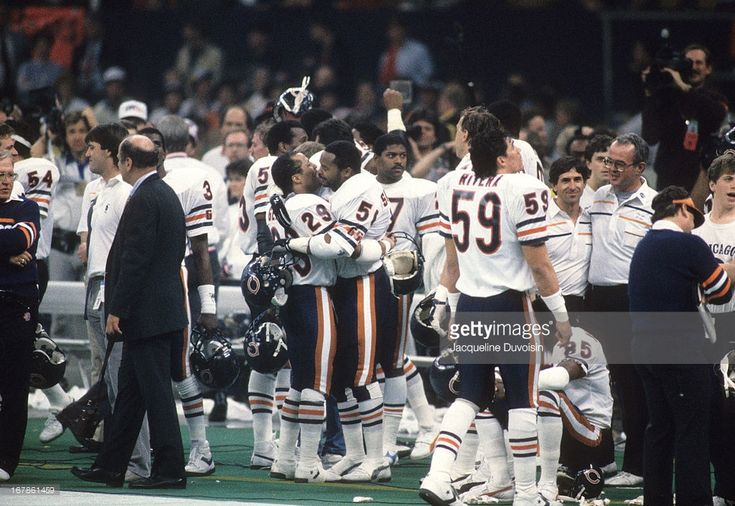 Chicago Bears Dennis Gentry (29) and Jim Morrissey (51) victorious, hugging on sidelines after winning game vs New England Patriots at Louisiana Superdome. Jacqueline Duvoisin F12 )