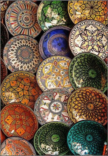 Maybe create a round tile with vegetal designs in a rotational design