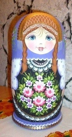 Matryoshka (Russian nesting doll) with two plaits in a beautiful apron. #Russian…