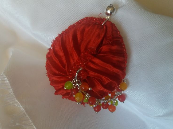 Cod-353 Red flame shibori silk frame adorned with silver plated ornaments and natural semi-precious stones.  https://www.facebook.com/Crown-Art-Jewelry-685629774912291