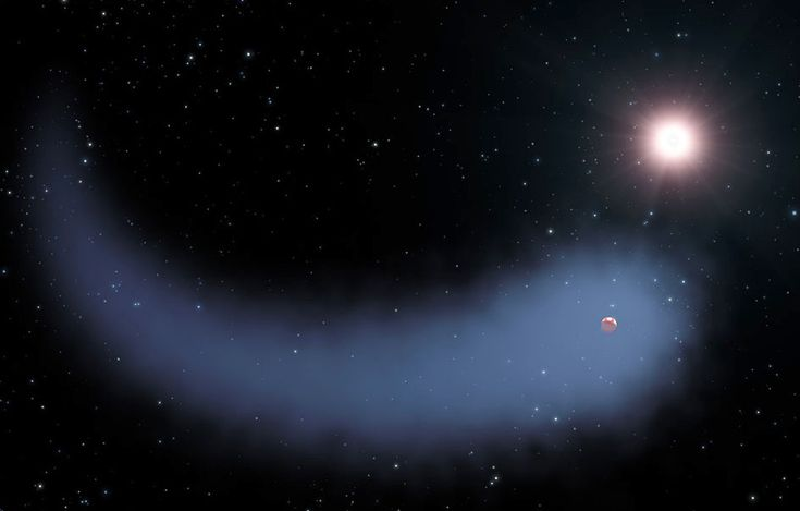 This artist's concept shows the enormous comet-like cloud of hydrogen bleeding off of the warm, Neptune-sized planet Gliese 436b just 30 light-years from Earth. Also depicted is the parent star, which is a faint red dwarf named Gliese 436. The hydrogen is evaporating from the planet due to extreme radiation from the star. A phenomenon this large has never before been seen around any exoplanet. Image credit: NASA, ESA, STScI, and G. Bacon.