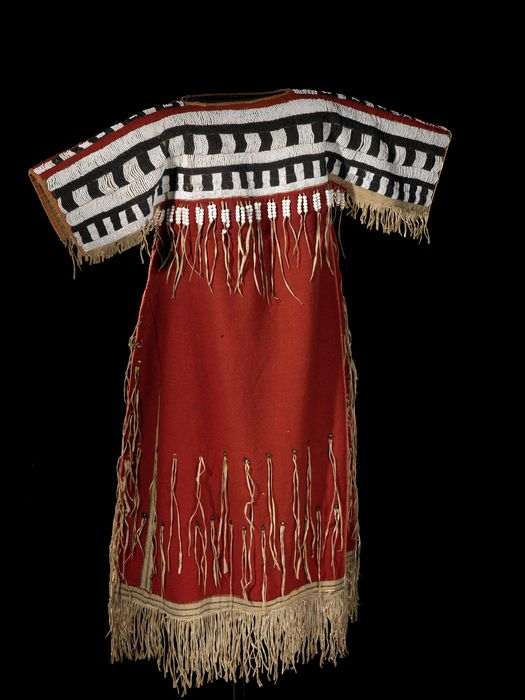 Woman's dress, Siksika Blackfoot, circa 1860, Wool cloth, glass pony beads, glass bead/beads, thread, hide. Sewn, lazy/lane stitch beadwork