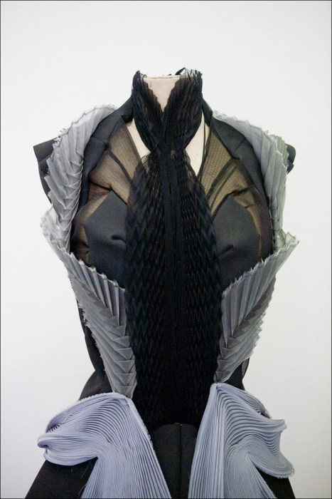 Dress design using a mixture of draped pleats to create structure & symmetry - fabric manipulation; creative draping; couture techniques