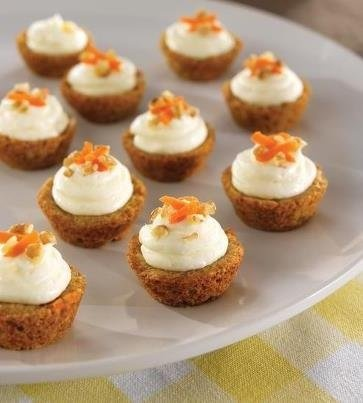 Mini Carrot Cake Cups - Pile on the frosting! Our homemade, cream cheese icing makes these Mini Carrot Cake Cups irresistible!