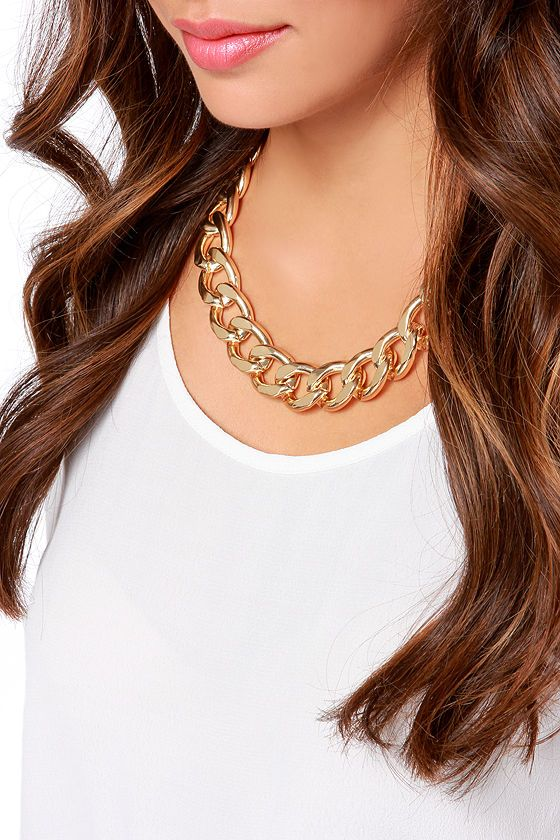 "What do we like best about the Best of All Gold Chain Necklace? Well, this chunky chain necklace with glimmering gold links and a short collar length goes with pretty much everything you own! Necklace measures 1"" wide and 16"" around, plus a 3"" extender chain. Lobster clasp closure. Man made materials."