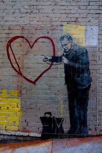 World-famous graffiti artist Banksy's work entitled, Peaceful Heart, located at 720 Grant St in Chinatown. The bakery next door has put up a protective sheet of plexiglass over the artwork to ensure that no one damages it.