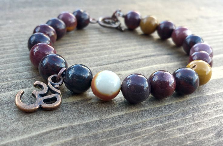 Mookaite Jasper with an Om by NidraBeads on Etsy