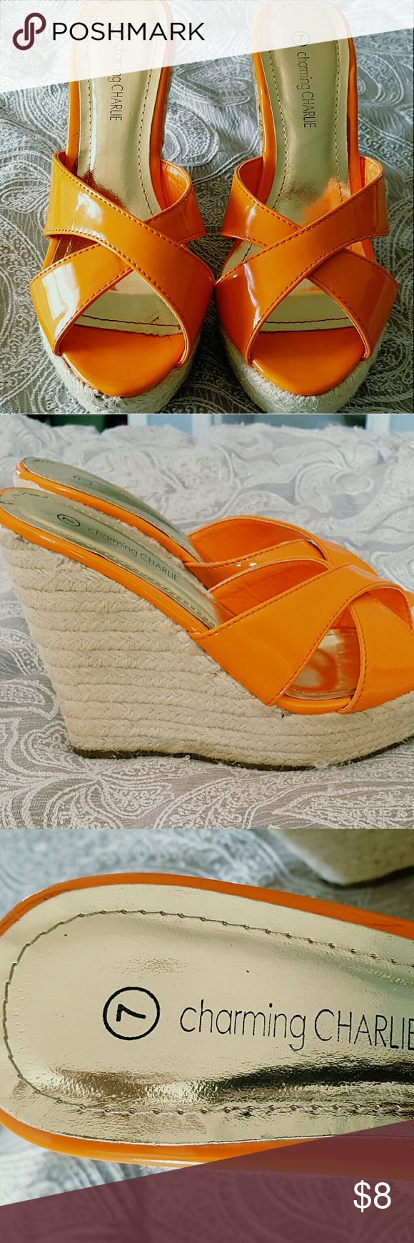 Charming Charlie Orange Wedges Bright orange with gold accent. Tan heel. Used, in good condition. Bottoms are scratched but rest of wedge looks good. These wedges are pretty tall (so walk carefully). Charming Charlie Shoes Wedges