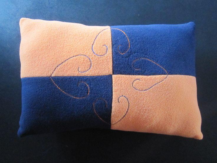 A Koru and Heart inspired cushion.