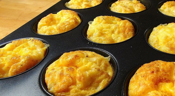 Saute and ham (or bacon or sausage); wisk 8 eggs, 1/4 cup milk, 1/2 tsp oil, 1/2 tsp baking powder, season with salt & pepper. Divide in muffin pan layering onion & meat, grated cheese, and egg mixture. Bake at 375 F for 20-25 minutes, let sit i pan 5 minutes before plating: http://tiphero.com/oven-baked-mini-omelets-for-quick-and-easy-breakfasts/?utm_source=fbbp&utm_medium=dk&utm_campaign=oven-baked-mini-omelets