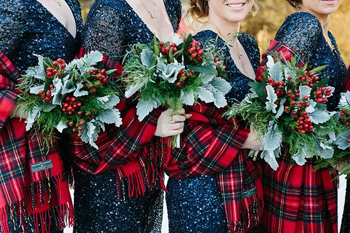 Holly and dusty miller bridesmaid bouquet with red plaid shawls = holiday