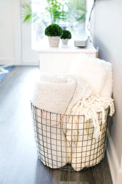 If there's one thing y'all know I love, it's a great couch nap! But no nap time is complete without a cozy blanket. I store mine in this fun oversized wire basket right next to the sofa for easy access and heck...they look so pretty it's added home decor!