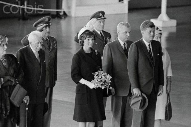 President and Mrs. John Kennedy; Prime Minister and Mrs. John Diefenbaker stand during playing of the National Anthem, shortly following the Chief Executive's arrival here May 16. In the back is Group Captain C.H. Mussells. | Location: Uplands, Canada. Date Photographed:16 May 1961