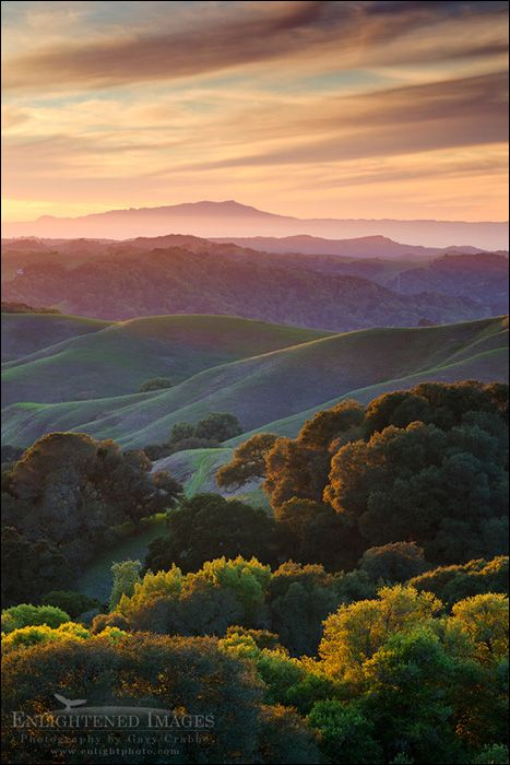 Picture: Sunset over the green east bay hills looking toward Mount Tamalpais in distance, from Briones Regional Park, Contra Costa County, California by Gary Crabbe