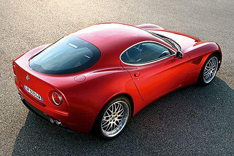 """First shown at the 2006 Paris Auto Show, the Alfa Romeo 8C Competizione ($200,000; late 2008) is finally making its way stateside. The retro-styled racer features a 4.7-liter, 450hp V8 engine, carbon fiber body with steel chassis, a 6-speed robotic gearbox, 20"""" wheels, and looks that would please even the most discerning car connoisseur."""