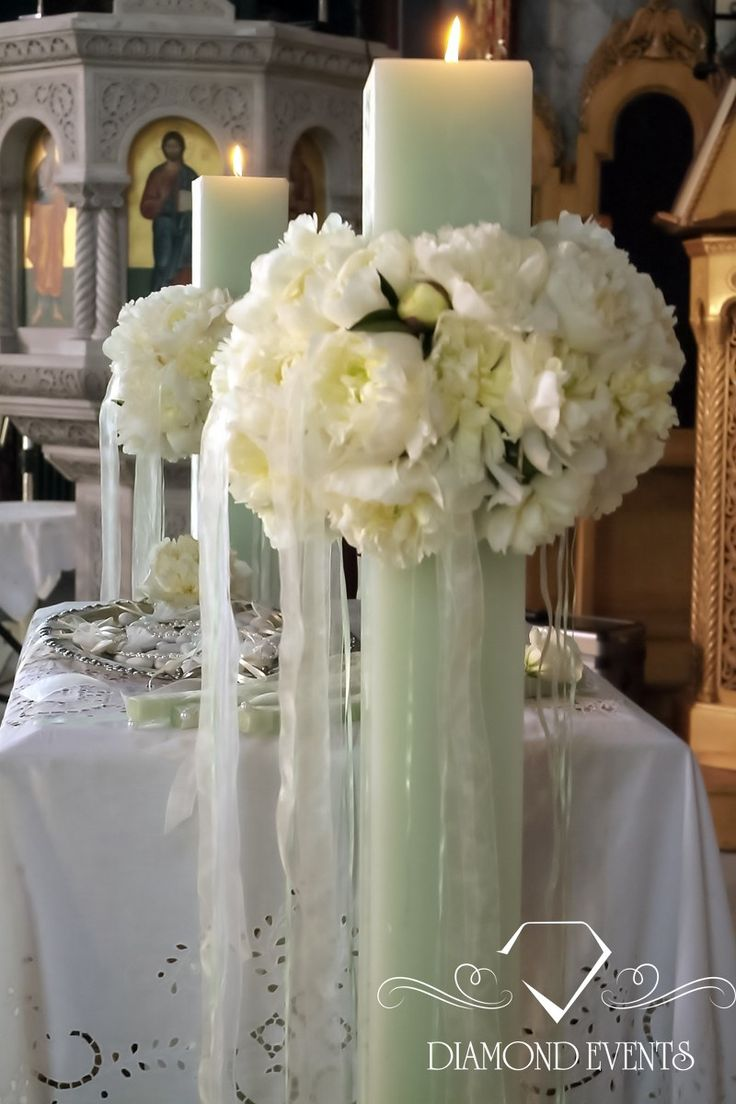 #Square wedding #candles with white #floral #wreaths! Visit our website for more ideas www.diamondevents.gr