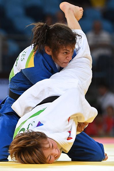 #RIO2016 Best of Day 1 - Mongolia's Urantsetseg Munkhbat competes with Brazil's Sarah Menezes during their women's 48kg judo contest repechage match of the Rio 2016 Olympic...