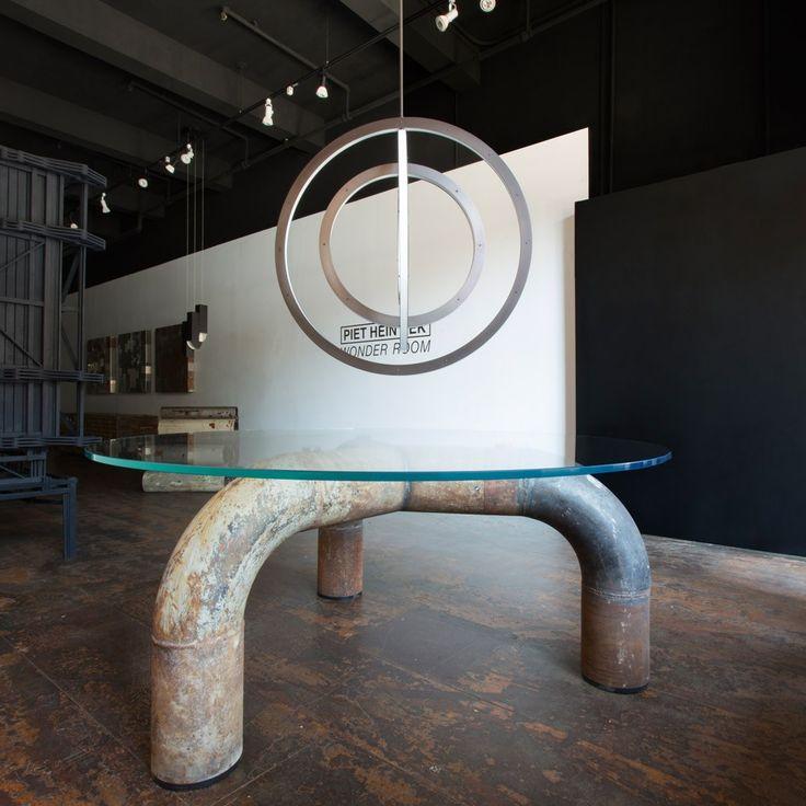 """RAG pipe table van `Piet `Hein Eek. Een tafel gemaakt van oude pijpen en een glazen tafelblad. Het is een limited edition ontwerp. 74"""" D x 31"""" H prijs op aanvraag"""