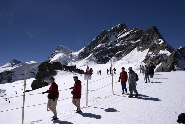 Swiss Alps - Tourists walking along the slope of the mountain  #switzerland #lucerne #adventure #snow #alps #fun #experience #interesting #travel #traveltherenext #mountain #train