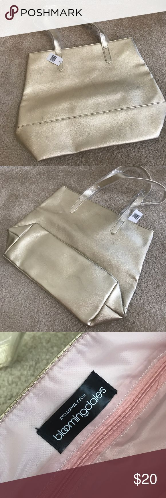 Metallic Everyday Tote Bag Metallic Tote bag / Can be used for everyday / Exclusive GWP from Bloomingdale's / Last picture shows size in relation to a pair of sunglasses / Metallic gold color, perfect for summer / Lined with pink fabric / One zipper pocket Bloomingdale's Bags Totes