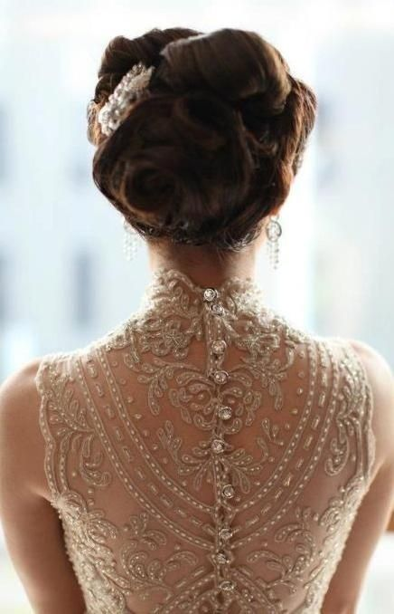Beautiful bridal button down back and an amazing hair style
