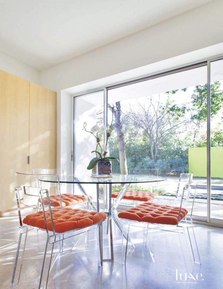 Breakfast Room With Lucite Table And Orange Cushions
