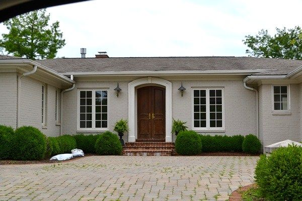 painting brick houses - light cream or grey with white trim and black accents