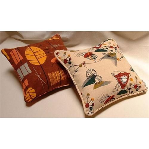 Traditional Decorative Pillow from Melinamade, Model: Featured here in Tiki Rust and Tinkertoy.