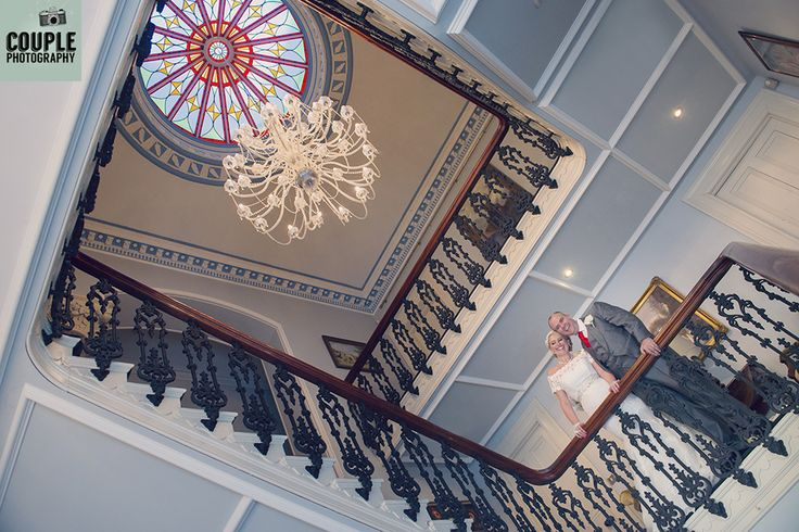 The beautiful staircase at Moyvalley. Weddings at Moyvalley Hotel and Golf Resort Photographed by Couple Photography.