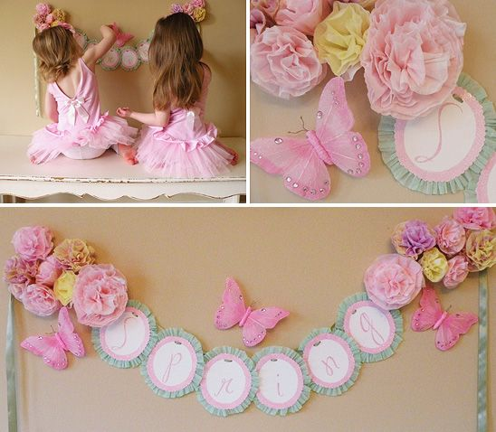 I think the back of that banner is just a large cupcake liner... so cute! Need to keep this is mind for Brenna's birthday in September!