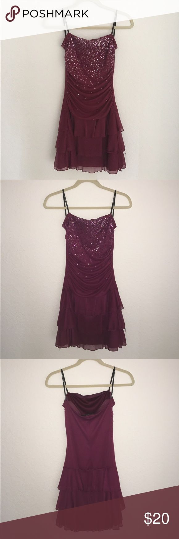 RAMPAGE strapless dress Strapless Rampage dress with sewn on sequence on top. Beautiful embellishments on this plum colored dress and only worn once! Rampage Dresses Strapless