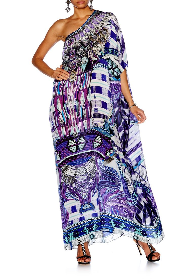 CAMILLA: RITUAL RHAPSODY ROUND NECK KAFTAN. Offering a rich, lavish and exotic display of African-inspired prints and patterns, the pure silk Round Neck Kaftan feels magnificent to the touch. In a relaxed fit, the fluid silk crepe fabrication and hand embellished crystals make this number a bohemian wardrobe treasure.