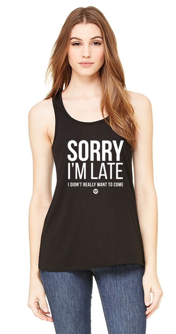 Sorry Not Sorry Tank - Sometimes we're sorry and other times, not so much. A Racer back style tank with a looser bottom for ease of movement, the Sorry Not Sorry Tank is the perfect piece to go with your SI Exclusive Leggings.  Racerback tank Flowy on the bottom 91% Poly 9% Cotton Made in the USA