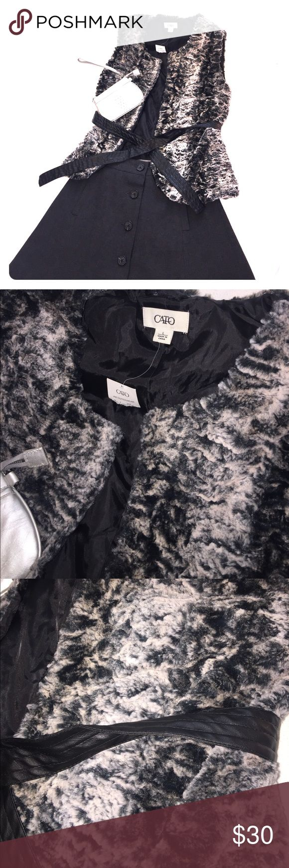NWT Faux fur vest with faux leather belt. Never worn. Super soft faux fur. Gray, black coloring. Fully lined. Size large but can fit medium and small because it can be cinched at the waist with the belt. Smoke-free home. Jackets & Coats Vests