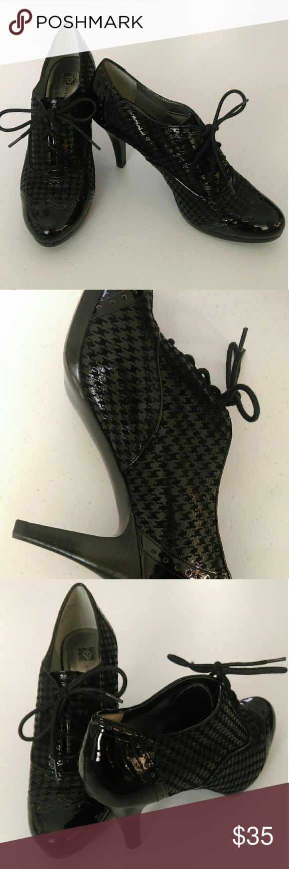 Patent High Heels All black patent shoes with a twist....high heels! They are trimmed with a very shiny black material. The body of the shoe is houndstooth patterned with the same shiny black material along with a velvety material. Some light wear on the bottom, but still in overall fabulous condition! These shoes make a statement while also looking savvy and classy.  Size 8 1/2 Ann Klein Shoes Heels #blackhighheelsshiny