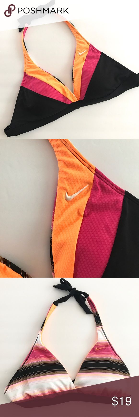 Nike Reversible Bathing Suit Top Triangle bikini top, tie at neck and back. Reversible. Black, pink, white, orange. Nike swoosh on both sides. Very faint stain on white side. There is a close up picture but it's difficult to see because it's light. No tag. Fits up to a large c cup. Nike Swim Bikinis