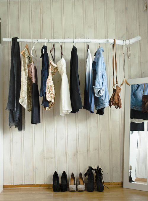 Rustic Clothing rack,painted branch, white wood walls.