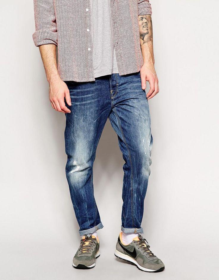 Jeans von G-Star Baumwoll-Denim Distressed-Waschung im verschlissenen Look geknöpfter Schlitz schmale Passform, sitzt eng am Körper Maschinenwäsche 100% Baumwolle unser Model trägt 32 Zoll/ 81 cm Normalgröße und ist 185,5 cm/ 6 Fuß 1 Zoll groß