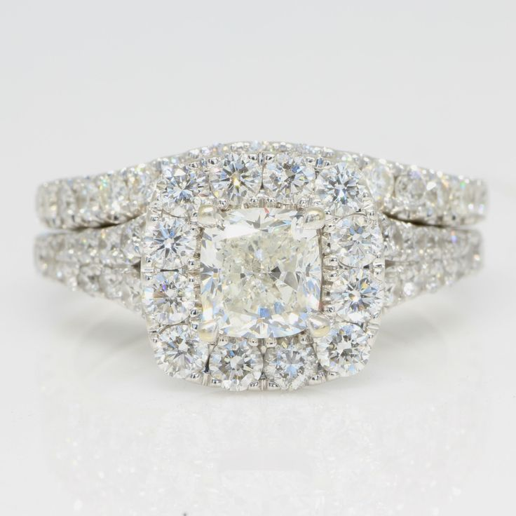 2 CTW Cushion Halo Engagement Ring and Wedding Band.  Diamond Exchange Dallas has a large selection of diamond engagement rings at wholesale prices.  Find our more about our selection at http://diamondexchangedallas.com/engagement-rings-dallas