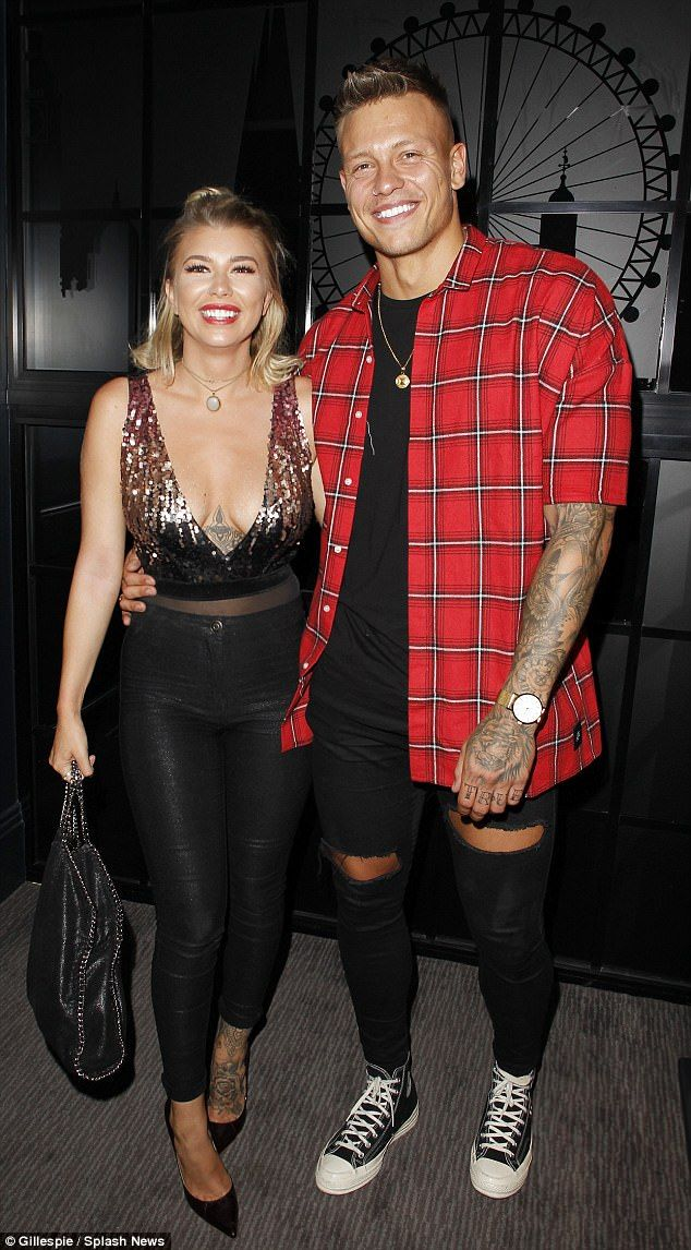 Loved up: Olivia Buckland, 23, looked ever so in love with Alex Bowen, 24, as they stepped out for a meal in London on Thursday