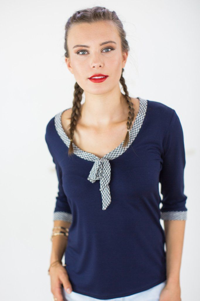 Top Pussy-Bow Navy.A flattering scoop neck, 3/4 length sleeves and cute bow detailing make this navy-colored top an everyday favorite. This top is slim fitting, finished with a beige and navy chevron patterned border on the cuffs and neckline. Would look perfect with a blazer for casual chic office look.