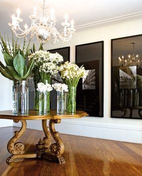 Stunning Round Foyer Table With Tall Glass Vases