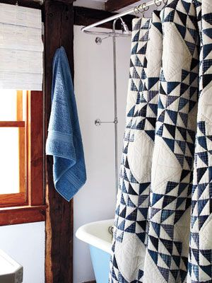 quilt shower curtain. Great use of an old quilt to display, need to spray with scotch guard of some sort before use.
