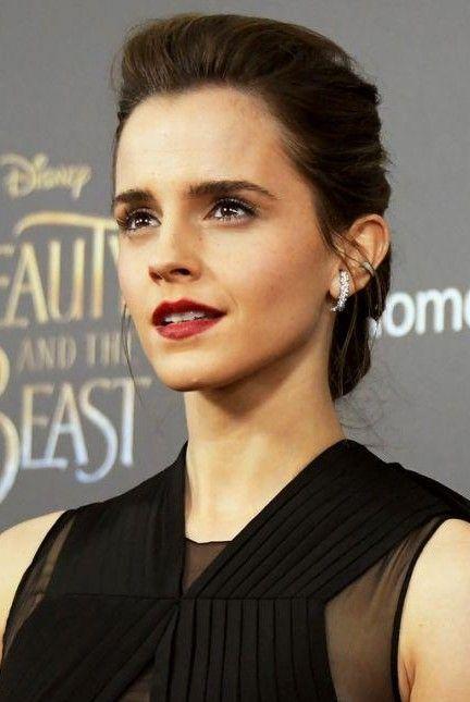 Looking for Emma Watson's maroon matte lipstick and dark curling mascara